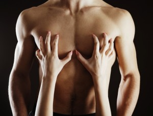 Close up of woman caressing her man's chest